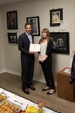 Congressman Tom Graves handing Katelyn Oliver her 3rd Place Award at the Congressional Art Competition Exhibition