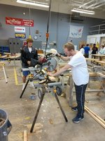 Jacob Clemmons using a miter box and stand that was donated by Harbor Freight