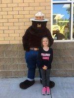 Carleigh Lunn and her Hero, Smokey the Bear