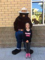 Carleigh Lunn and her Hero, Smokey the Bear