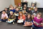 Southland Academy first graders eagerly read books donated by the Maddens.