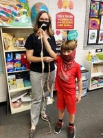 Pictured:  Substitute teacher, Leslie Blankenship, and Cole Watson , who is a Southland Academy student in Mrs. Rooks` class, hold a really long snakeskin and a shorter snakeskin.