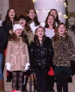 Southland fourth graders participate in the Canes Community Christmas program on the steps of the Wheatley Building at GSW.