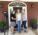 Pictured with Olivia Perry (center) are Sue Bradley and Jena Tyler presenting Olivia with the winning check.