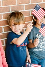 Southland Academy K4 student, Carson, is proud to wave the flag in honor of our veterans.