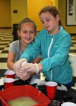 Pictured: Third graders, Charlotte Brown and Lanier Yeiser, can`t wait to see how the vinegar and water turn into plastic.