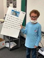 Southland Academy third grader, William Walker, presents his science project about polar bears to his class.  Kasey Ivey is the third grade science teacher.