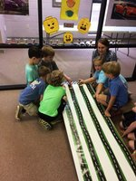 Pictured are Southland lower school students with their Legos race cars  taking the track for the