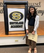 Pictured:  Congratulations to Nikki Remollino for earning the most points read award, being a Top 10 Reader, and reading over one million words during the 2019-2020 school year.