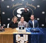 Southland Academy running back Clay Owens signs his National Letter of Intent to continue his education and play football at Charleston Southern University. Seated left to right are April Owens (Mother), Clay Owens, Joel Owens (Father). Standing is Southland Academy Head Football Coach Rod Murray.