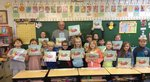 Pictured is Mr. Terrell Turner with a group of first graders.