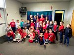 Pictured are members of Mrs. Heather Yeiser`s first grade class and some of the Dental Partners representatives.