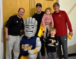 Pictured with the Surge are Coach Ty Kinslow, John, Thor, and Mila Taylor; and Will Krenson.