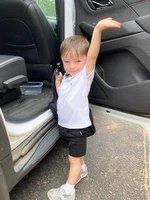 James waves good-bye as he leaves school.