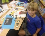 Samuel Kelley is shown with his yummy science example of the phases.