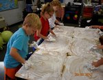 Pictured are first graders in Mrs. Lisa Collins` class enjoying a sensory activity.