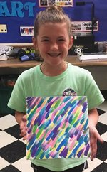 McGraw Minor displays her artwork from the Southland Academy summer camp program.