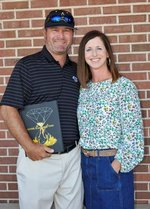 (Coach Rod Murray and his wife, Meredith Murray, celebrate the honor of the 2019-2020 Yearbook dedication.)