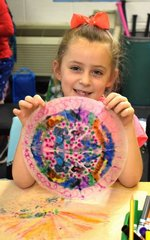 Pictured: First grader, Liberty Burnsed, is proud of her symmetry art.