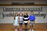 Pictured are Mia Hughes and Carli Davis (K5), Hannah Horne (2nd grade) and Daniel Reagan (3rd grade).