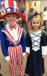 (Pictured) Uncle Sam, Wes Brock, and Betsy Ross, Miller Anne Pryor, greeted guests at the Veterans Day program.
