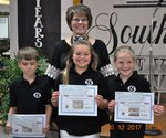 Pictured are Will Kinney, Sydnee Kobs, and Peyton Horn with their art teacher Kristy Swinson.