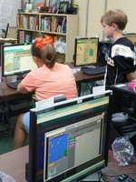 Shown in the picture are fourth graders Wes Brock and Campbell Wiggins. Campbell has mastered a level that was proving to be quite difficult. She then began to help others through the difficult level. This is a major component of the CODE program-teamwork. Way to go Campbell!