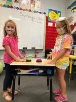 Southland Academy first graders,Brooklyn and Owen, play a round of the math buzzer game.