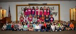 Pictured are members of the Hurricanes Lady Soccer Team with some of Southland`s young Raiders.