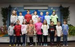 Pictured are 3rd graders showing how they chose to celebrate the 100th day of school.
