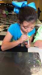 Emory Webb, a second grade student in Mrs. Lorrie Ledger`s class, enjoys the Bubble inside a Bubble science experiment.