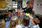 Pictured: Teacher Lori Bell is surrounded by K3 students as they excitedly wait to see the snow.