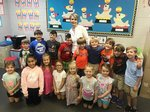 Pictured are Southland Academy First Graders and their monthly visitor, Mrs. Nancy Owens.