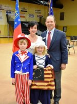 Uncle Sam (Hampton Lloyd) and Betsy Ross (Caitlin Kidd) celebrate the Veterans Day program with Headmaster, Ty Kinslow and Lower School Director, Laura Kinslow.