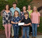 Southwest Georgia Academy alumnae, Spring Minick and Carol Burrell, their children Will Minick, Jadie Burrell and Gracie Burrell, and also other Southland students Emma FitzGerald and Hayes Hagerson are proud of Southland's donation made to Southwest Georgia Academy to help with the rebuilding of their school and sports facilities due to the devastation of Hurricane Michael.