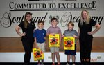 Pictured with Dr. Veilands` staff are third graders, Turner Simmons, Brooks Potter, and Cade Ledger.