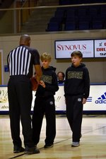 Bryant Roland and Mac McMichael show their Raider Spirit as they presenet the GSW men`s basketball game ball to the referee.