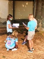 Pictured: Southland Academy Fourth Grade students find an exposed tree root while on their science scavenger hunt.