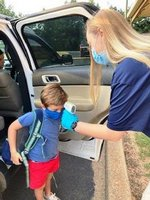 Ashley Ansley welcomes Southland K5 student Davis Smith and takes his temperature as a part of the daily routine for students upon arrival to school.