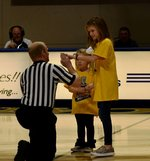 Emily Claire Bailey and Adley Coombs present the GSW women`s basketball game ball to the referee.