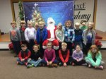 Shown with Santa are students in Mrs. Peggy Roquemore`s First Grade Class.