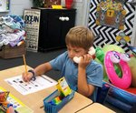 Pictured: Southland first grader, James Graft, uses a whisper phone while reading.