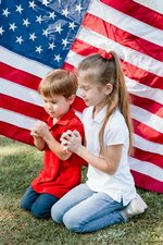 Mia and Samuel Hughes give heartfelt prayers for veterans.