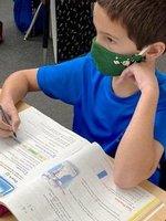 Southlanda 5th grader Luke Hall studies decimals.