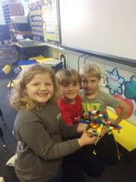 Laura Beth Dixon, Samuel Kelley, and Mason DeBaise are shown proudly displaying a portion of their construction.