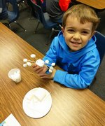 Pictured: Southland Academy K4 student, Trayce, is proud of his original snowflake.