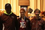 North Haven`s Elise Symon placed 12th at the State Open and qualified for the New England Championship. Pictured here: Coach Carl Jackson, Elise Symon & Coach Jerry Munck. Photo courtesy of Heather Maki