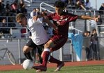 Pioneer Valley Panther Josh Cortez fights for the ball in a 2-0 loss to Colton High during a CIF playoff quarterfinal game at Pioneer Valley.  Photo by Daniel Dreifuss/SM Times