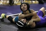 Pioneer Valley's Beatriz Barlista, on top, pins Righetti's Betzy Bras during a wrestling match at Righetti High School Thursday night.  Photo by Daniel Dreifuss/SM Times