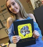 Autumn Whisenant, yearbook editor, shows last year`s Snapchat themed yearbook.